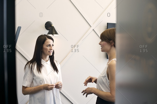 Businesswomen talking in hallway