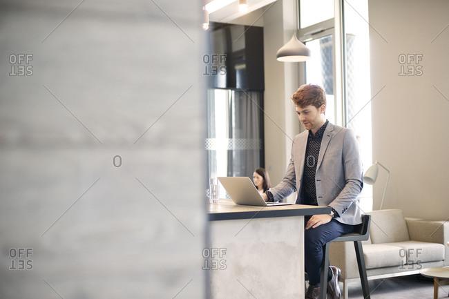 Businessman sitting using laptop