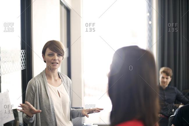 Businesswoman speaking at meeting