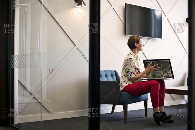Businesswoman presenting portfolio at business meeting