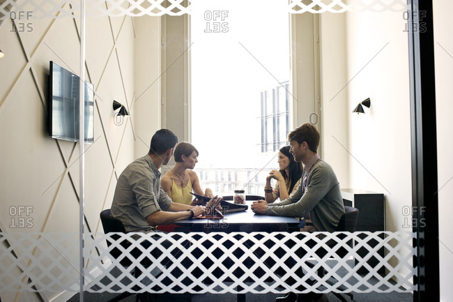 Four colleagues in a meeting