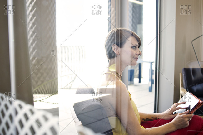 Businesswoman using tablet computer in office