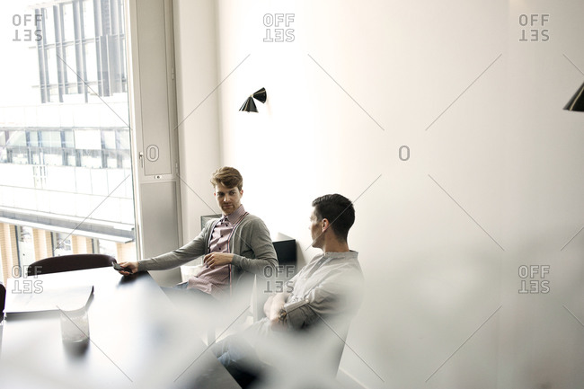 Male colleagues in meeting