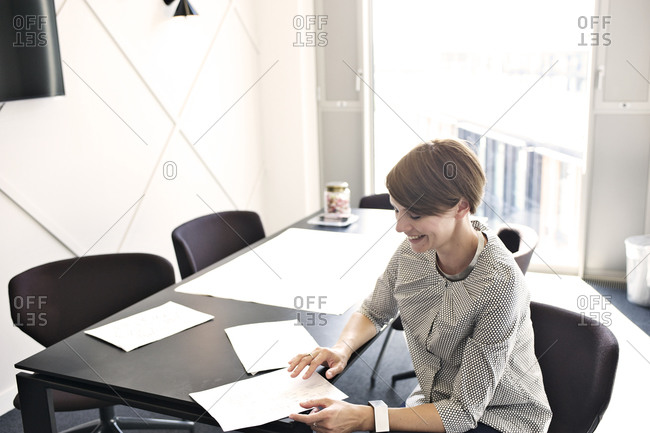 Businesswoman smiling as she works