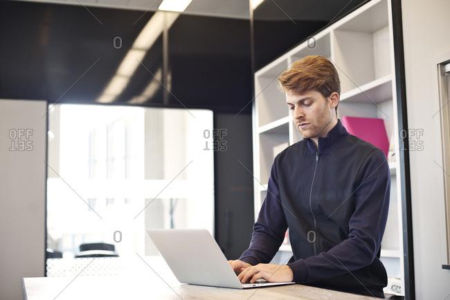 Bearded businessman using laptop computer