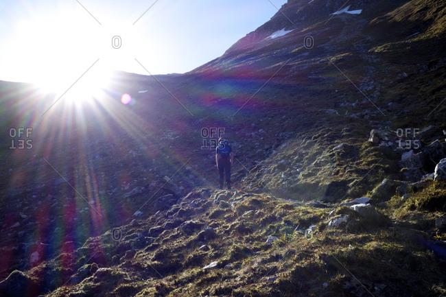 Man walking on mountain path