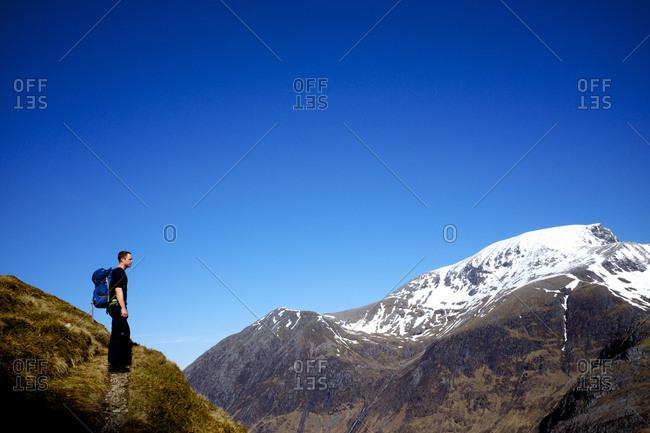 Man pausing during mountain hike