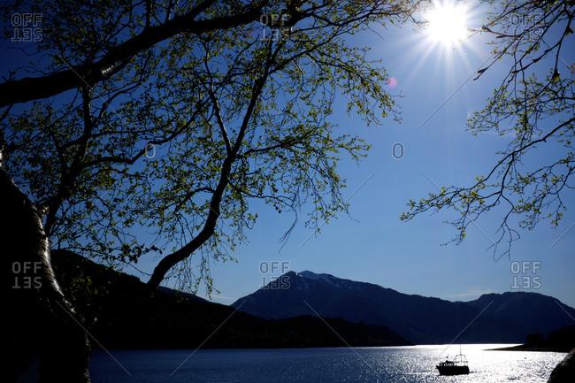 Fishing boat on mountain lake
