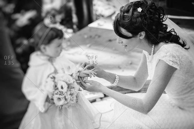 Side view of a bride and a little flower girl
