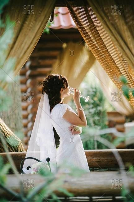 Side view of a bride drinking