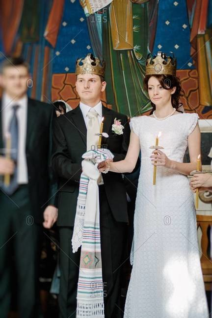 Crowning of the bride and groom during an Orthodox wedding ceremony