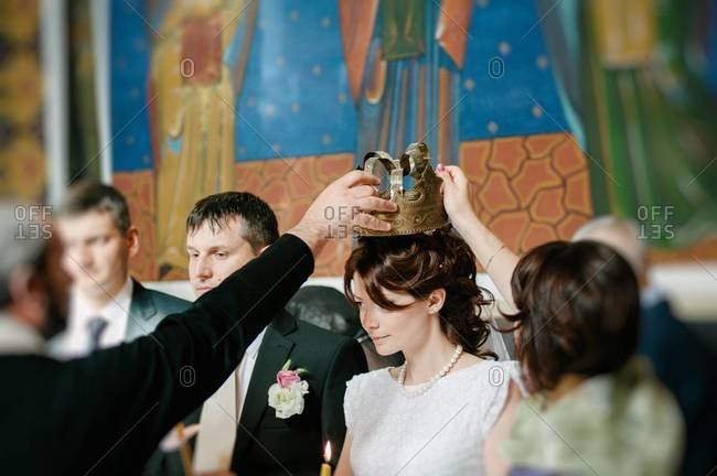 Crowning of the bride and groom at an Orthodox wedding ceremony