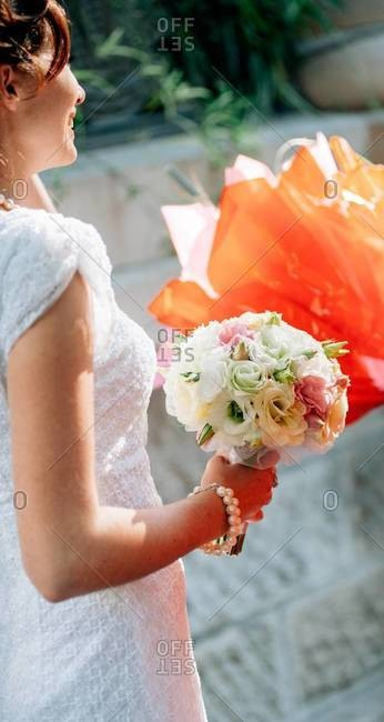 Side view of a wife-to-be with her bridal bouquet