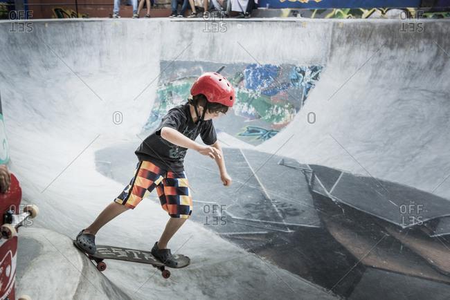 Boy riding skateboard in skate park