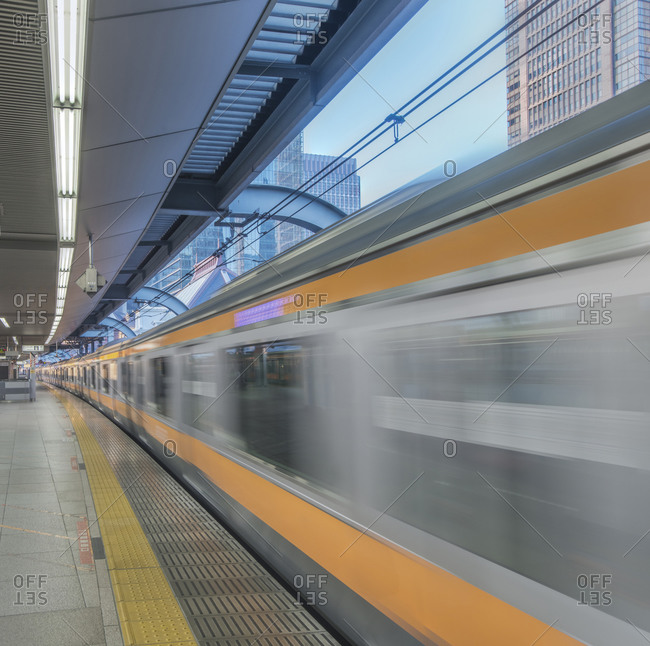 Blurred view of train leaving platform, Tokyo, Japan