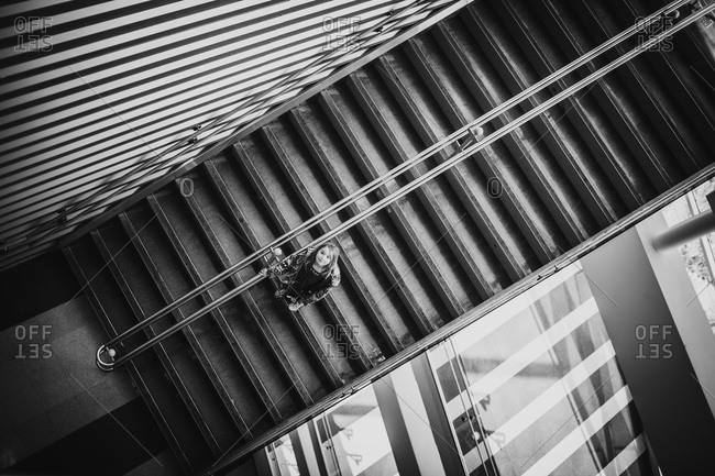 High angle view of a girl on a staircase
