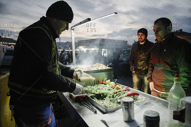 Istanbul, Turkey - February 8, 2014: Man preparing street food in Istanbul, Turkey