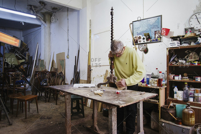 Istanbul, Turkey - February 8, 2014: Carpenter polishing a furniture in Istanbul, Turkey