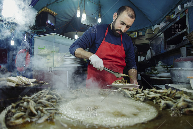 Istanbul, Turkey - February 8, 2014: Chef preparing food in Istanbul, Turkey