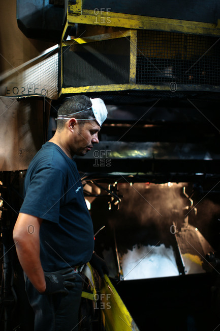 Rimini, Italy - October 10, 2012: Laborer at work in a foundry