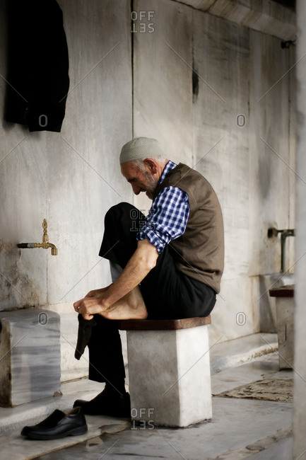 Istanbul Turkey - December 30, 2011: Muslim man putting on his socks after washing his feet in Istanbul, Turkey