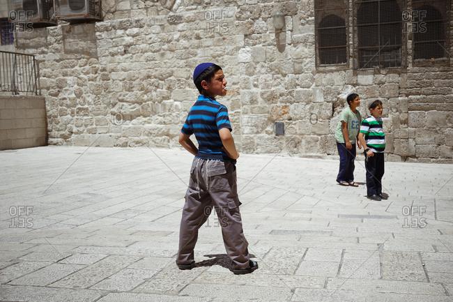 Jerusalem, Israel - April 27, 2013: Jewish boy blowing a bubble gum in Jerusalem, Israel
