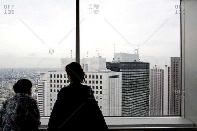 Women looking out of an observation deck in Tokyo, Japan