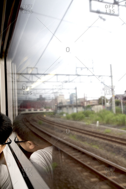 Boy sitting on a Narita Airport Express train