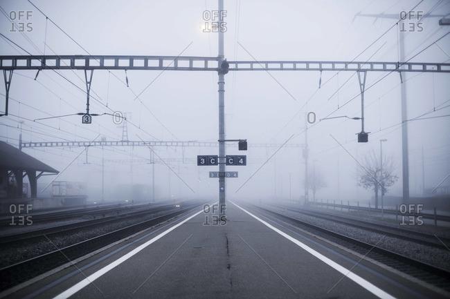 Train platform shrouded in fog