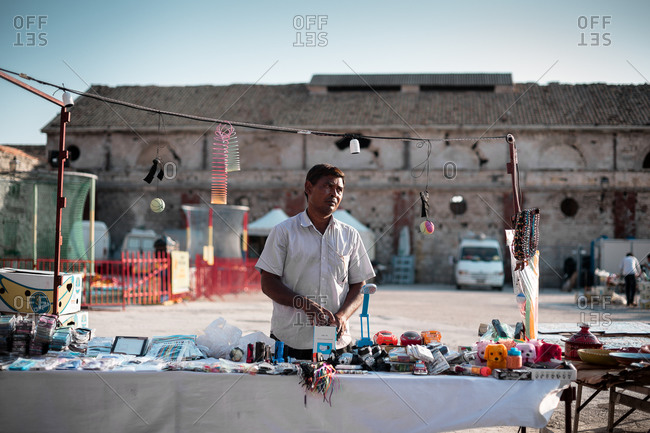 Favignana Island, Sicily, Italy - August 21, 2013: Street market seller
