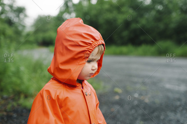 Young child in orange raincoat