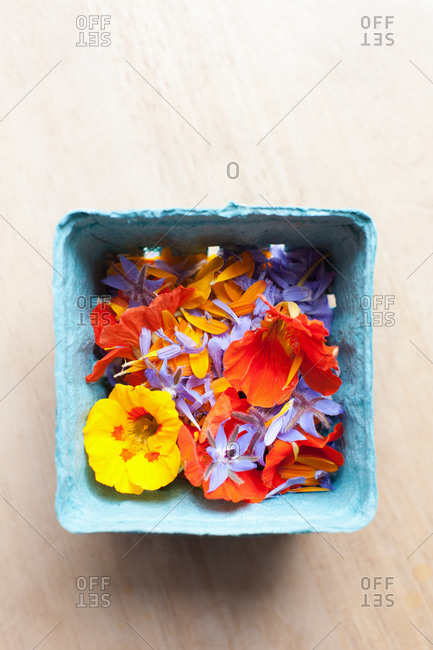 Edible flowers in a cardboard container