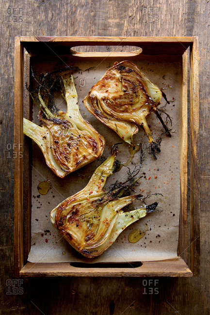 Roasted fennel bulbs in a crate
