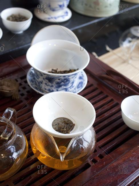 Kombucha tea brewing in a glass pot