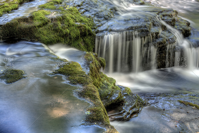 Water streaming over mossy rocks
