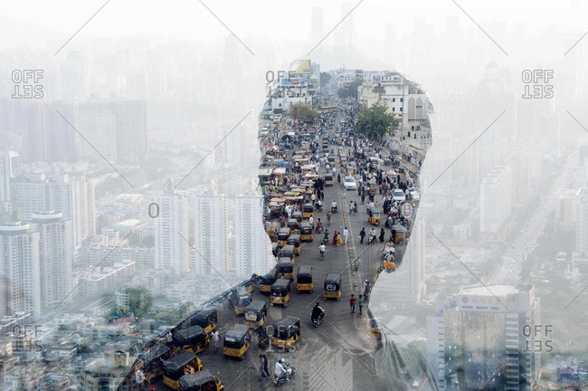 Silhouette of a person looking at a crowded street