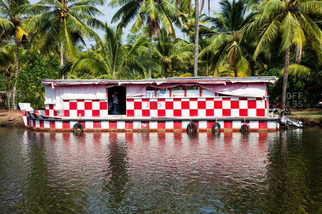 Boat decorated with a red and white checkered pattern