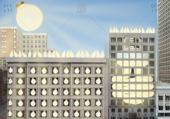 Light bulbs illuminating buildings