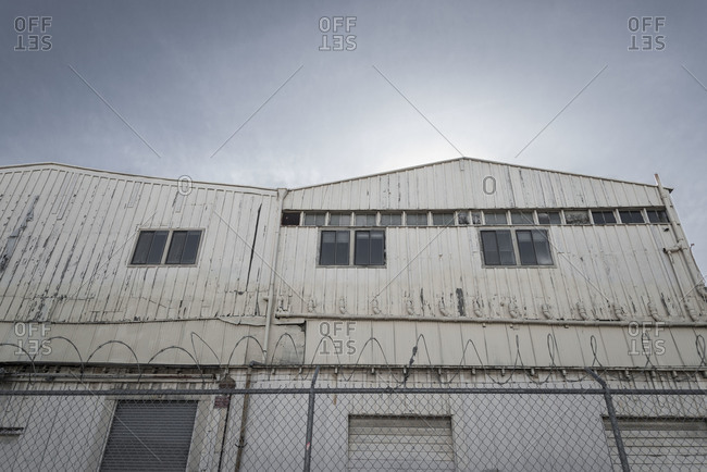 Building surrounded by a barbed wire fence