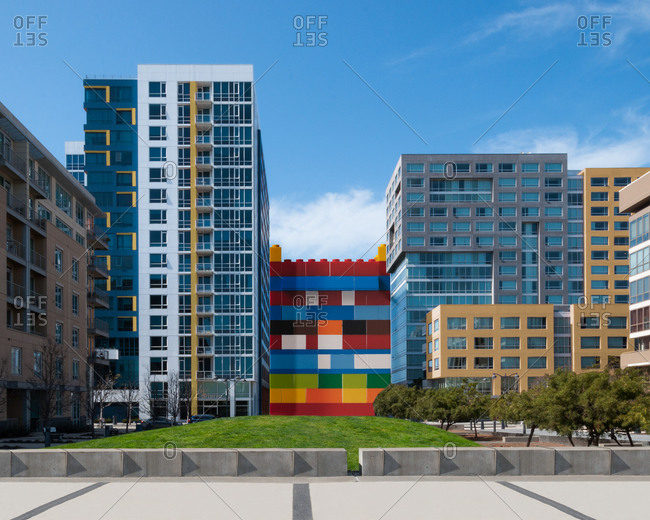Building made out of toy blocks between apartments