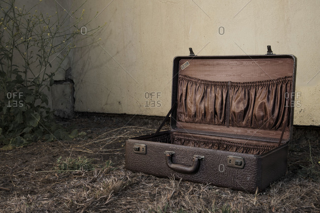 Empty vintage suitcase outdoors