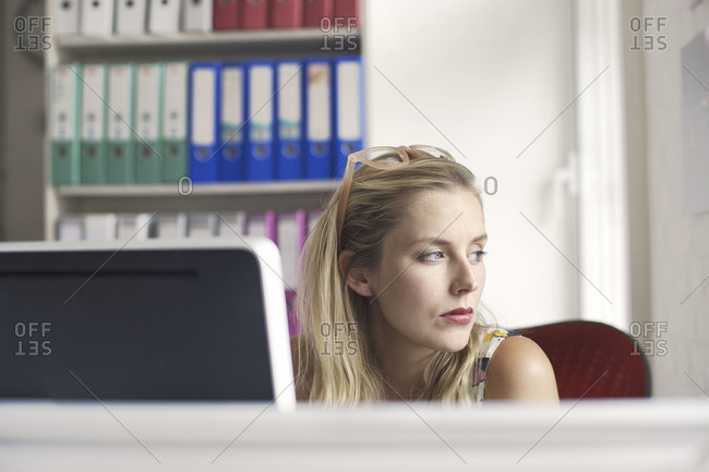 Portrait of a thoughtful woman in an office