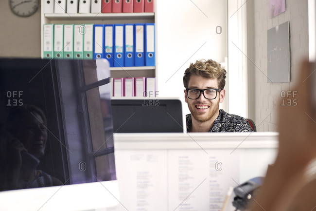 Man smiling in an office