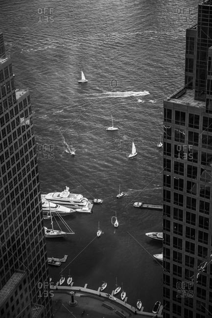 Boats sailing on a city coast