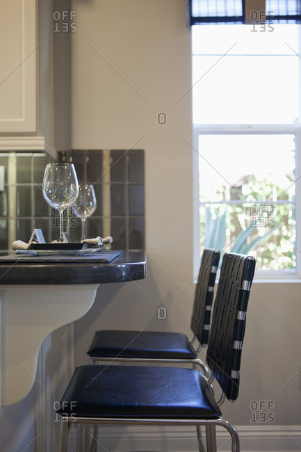 Chairs at counter in domestic kitchen