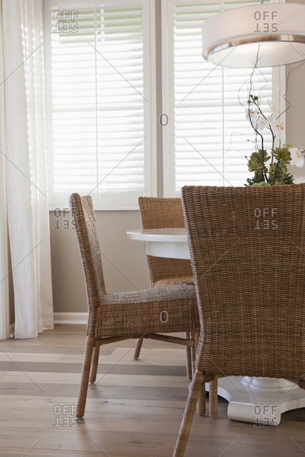 Wicker chairs at dining table in middle class house
