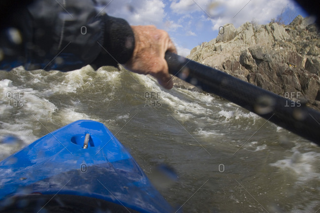 Point of view white water kayaking.