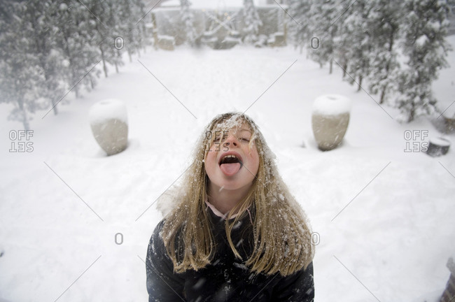 A girl plays outside after a snowstorm in Lincoln, Nebraska.
