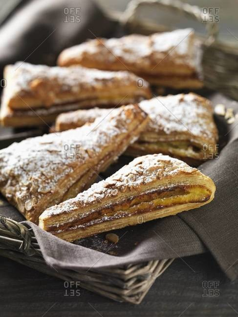 Almond puff pastries sprinkled with confectioners sugar