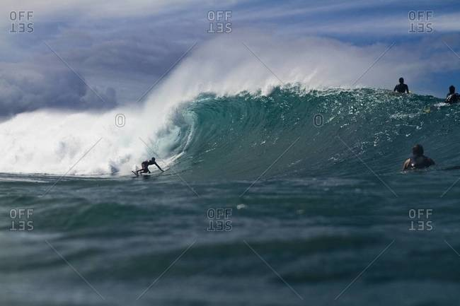 Surfer riding a pipeline in Hawaii